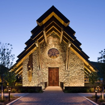 Exterior, square, front entry at twilight, Our Lady of the Snows Church, Ketchum, Idaho; McLaughlin & Associates