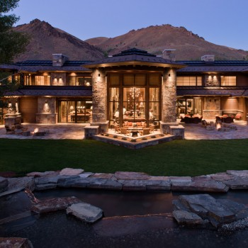 Exterior, horizontal, partial rear facade at twilight with water feature in the foreground, Beyer residence, Ketchum, Idaho; McLaughlin & Associates Architects