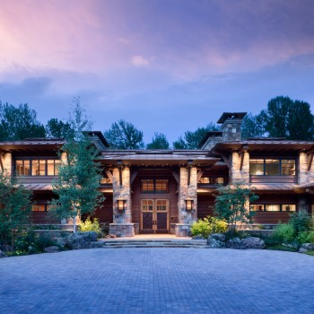 Exterior, horizontal, partial front view with entry at twilight, Dondero residence, Ketchum, Idaho; McLaughlin & Associates; Arentz Landscape Architects