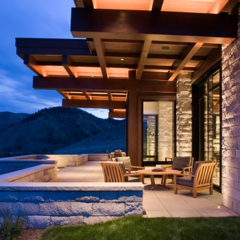 Exterior, horizontal, covered patio with cantilevered beams at twilight, Frey residence, Ketchum, Idaho; McLaughlin & Associates Architects