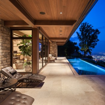 Exterior, horizontal, looking down rear patio toward pool and city view at twilight, Brock Residence, Lookout Mountain, Tennessee; McLaughlin & Associates Architects