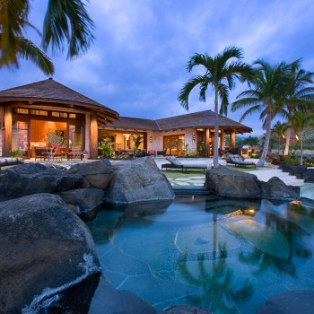 Exterior, horizontal, overall rear elevation and terrace with pool, hot tub and tiki torches at twilight, Sander residence, Manini'owali Kuki'o, Kailua-Kona, Hawaii; McLaughlin & Associates Architects; Studio Waterman
